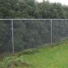 Top rail fencing in use